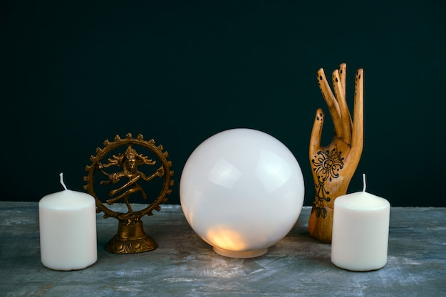 Esoteric still life with a crystal ball Premium Photo