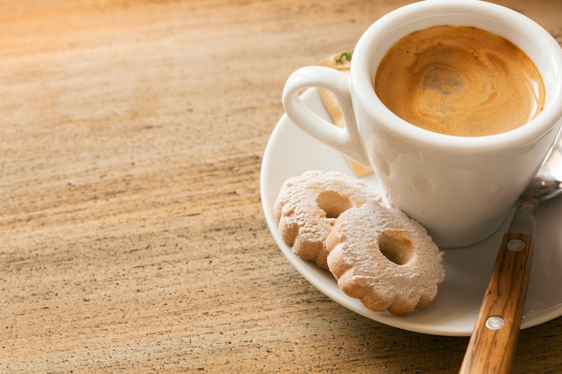 Espresso and biscuits with copy space Free Photo