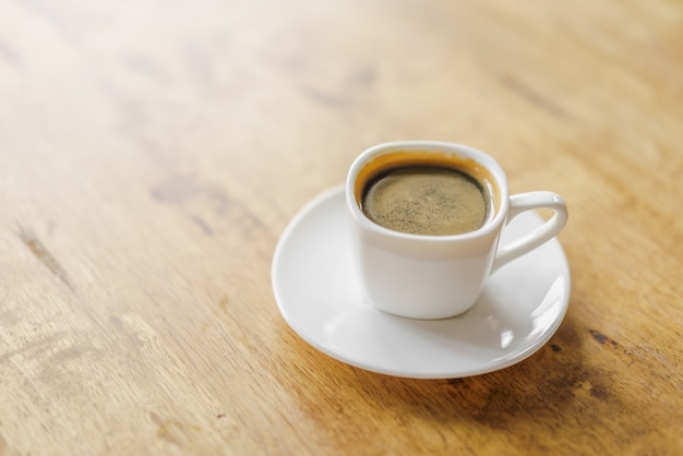 Espresso coffee cup on wood table Free Photo