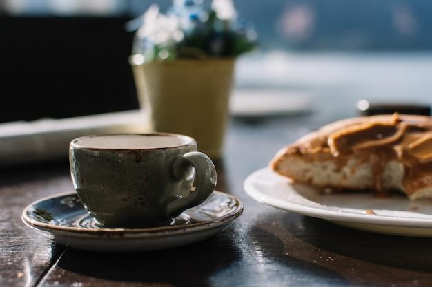 Espresso macchiato with caramel danish roll Free Photo
