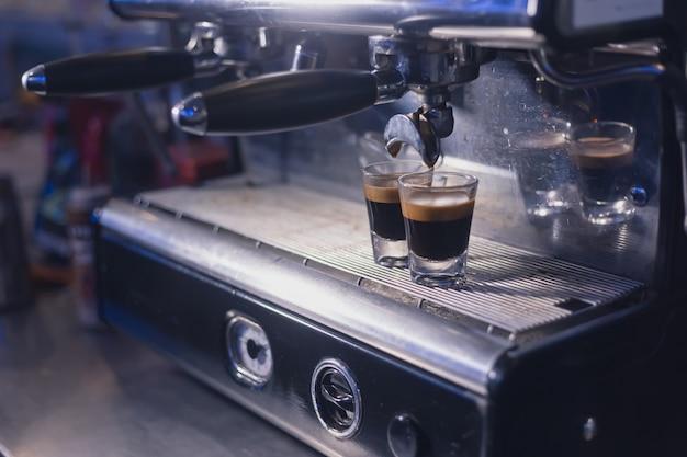 Espresso machine brewing a coffee Premium Photo
