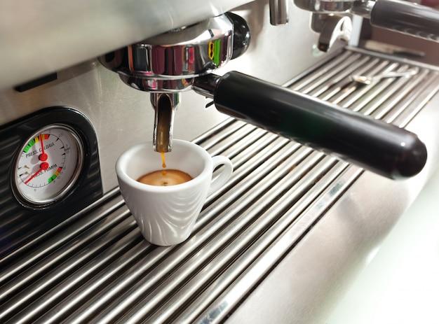 Espresso machine making a cup of coffee. Premium Photo