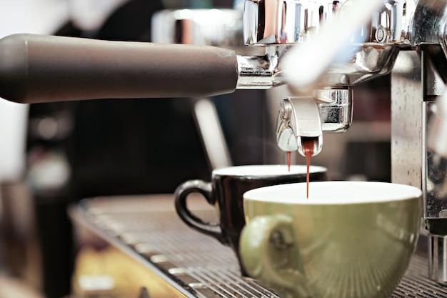 Espresso tamping.barista is preparing ground for espresso machine Premium Photo