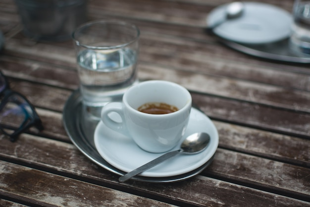 Espresso on a wooden table outside Free Photo