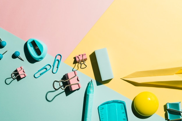 Essential office and school stationery on multicolored background Free Photo