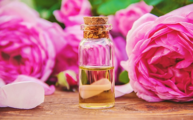 Essential oil of rose on a light background. selective focus. Photo | Premium Download