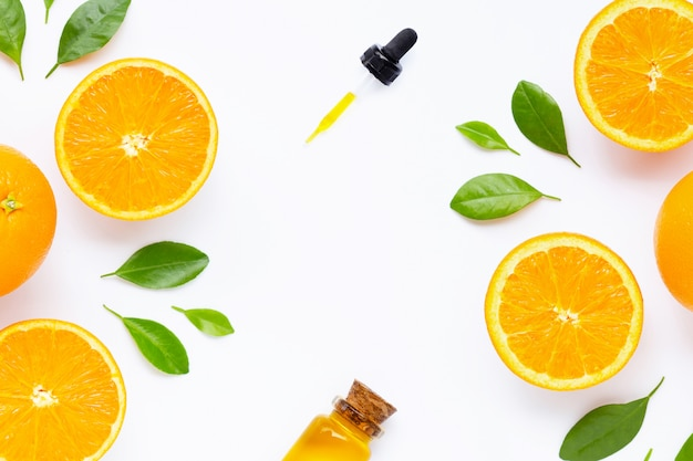 Essential oil with fresh orange citrus fruit with leaves isolated on white Premium Photo