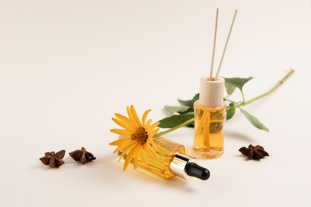 Essential oils and flower on plain background Free Photo