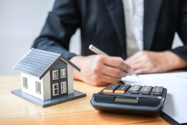 Estate agent working sign agreement document contract for house insurance approving purchases Premium Photo