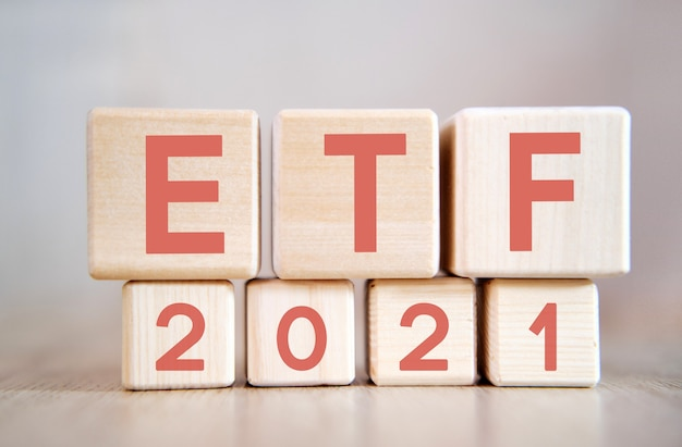 Etf 2021 on wooden cubes, on wooden background. Premium Photo