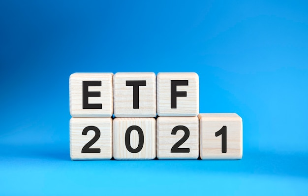 Etf 2021 years on wooden cubes on a blue background Premium Photo