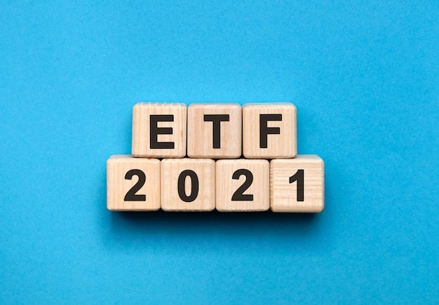 Etf - text concept on wooden cubes with gradient blue background Premium Photo
