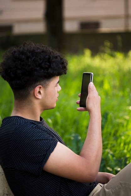 Ethnic youngster taking photo on street Free Photo