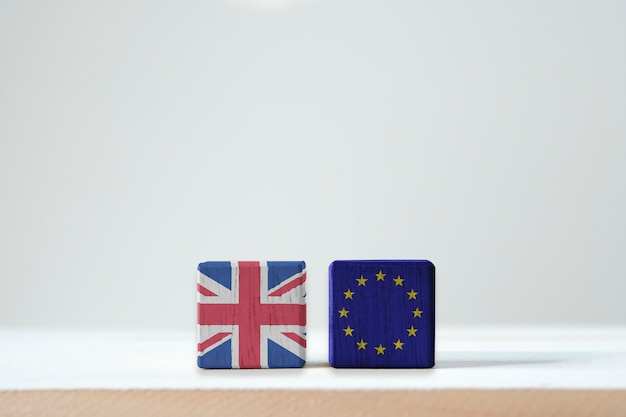 Eu flag and british flag print screen on wooden cubic. it is symbol of british need to exit or call brexit from european union members zone. Premium Photo
