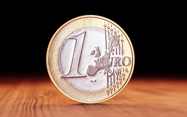 Euro coin on wood. 3d render Premium Photo