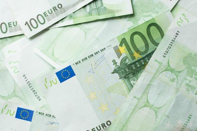 Euro money bank. rolled up euro bills background. one hundred euro bills. Premium Photo