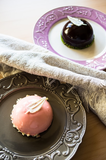 European sweets on the rustic plate Premium Photo