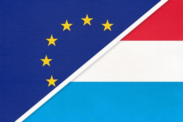 Европейский союз или ес против национального флага великого герцогства люксембург из текстиля. Premium Фотографии