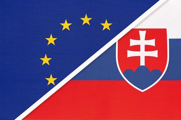 Европейский союз или ес против национального флага словакии или словакии из текстиля. Premium Фотографии