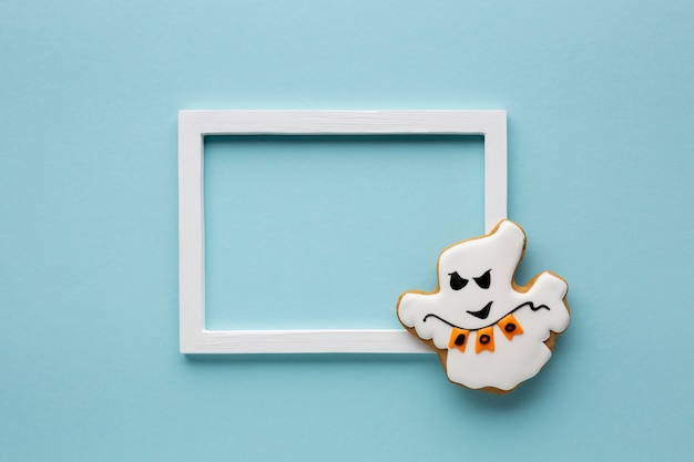 Evil cookie halloween ghost with frame Free Photo