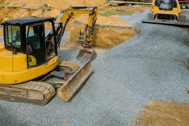 Excavation backfilling stone of foundation Premium Photo
