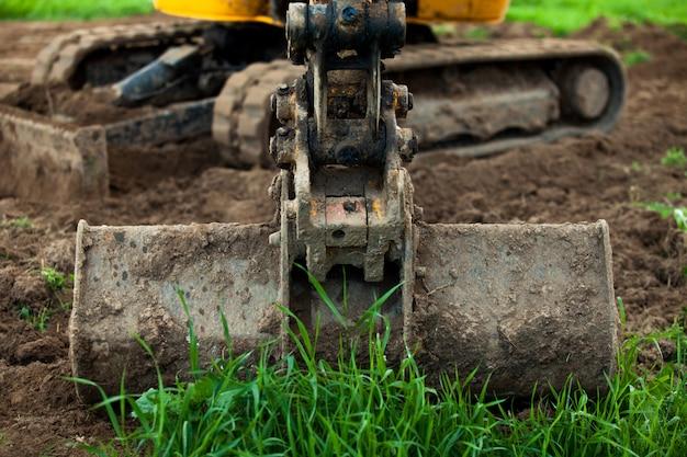 Excavator bucket wide spread land. Premium Photo