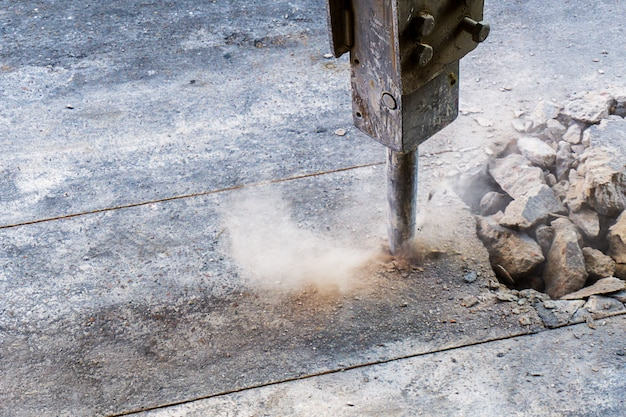 Excavator jack hammer in action and textspace Premium Photo