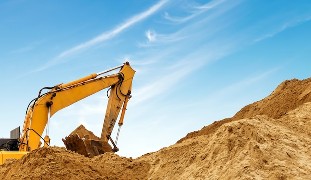 An excavator at work Premium Photo