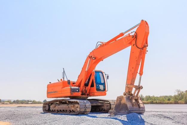 Excavators machine on a construction site on a construction site against blue sky Premium Photo
