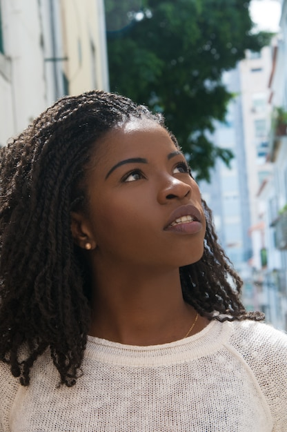 Excited african american female tourist walking in old city Free Photo