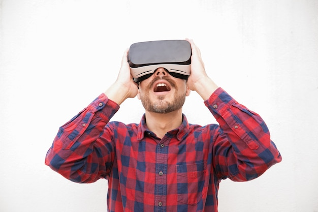 Excited bearded man in vr headset Free Photo