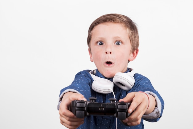 Excited boy playing video game Free Photo