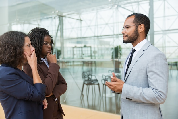 Excited business partners discussing work issues Free Photo