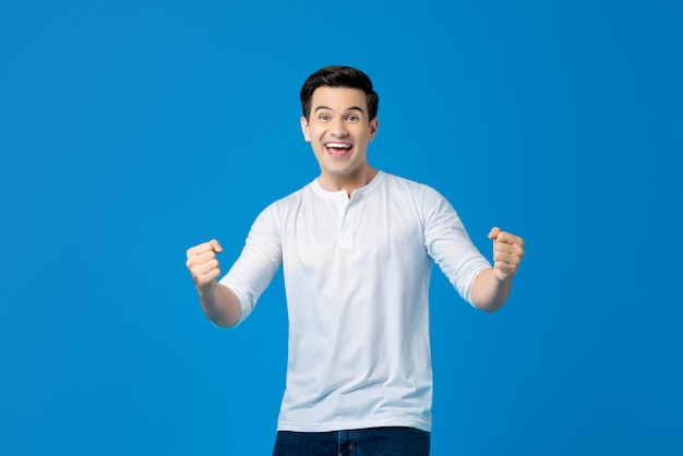 Excited caucasian man raising his fists doing yes gesture celebrating success Premium Photo