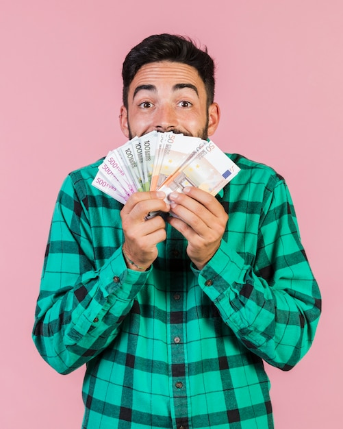 Excited guy holding money Free Photo