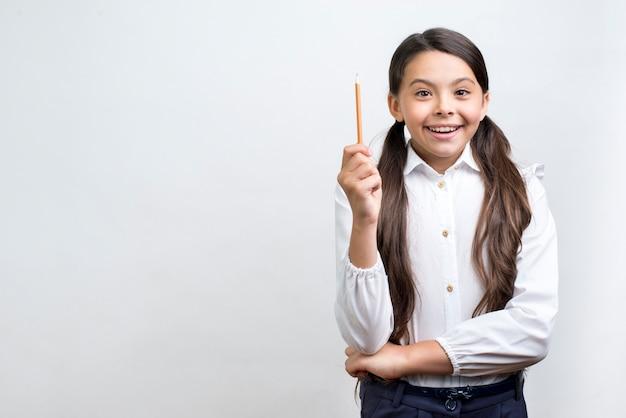 Excited hispanic schoolgirl having idea Free Photo