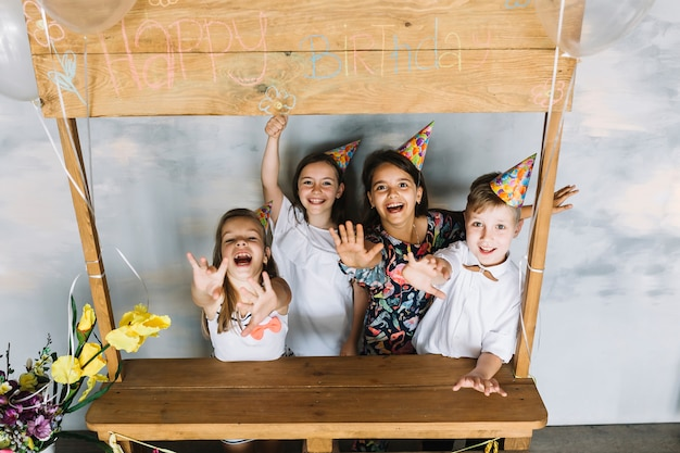 Excited kids stretching out arms on birthday party Free Photo
