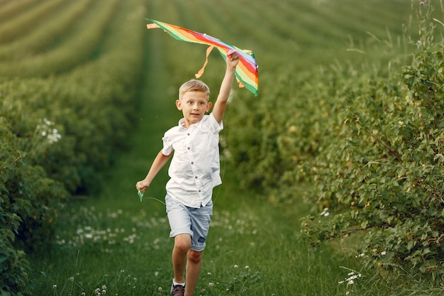 Excited little boy running with a toy plane Free Photo
