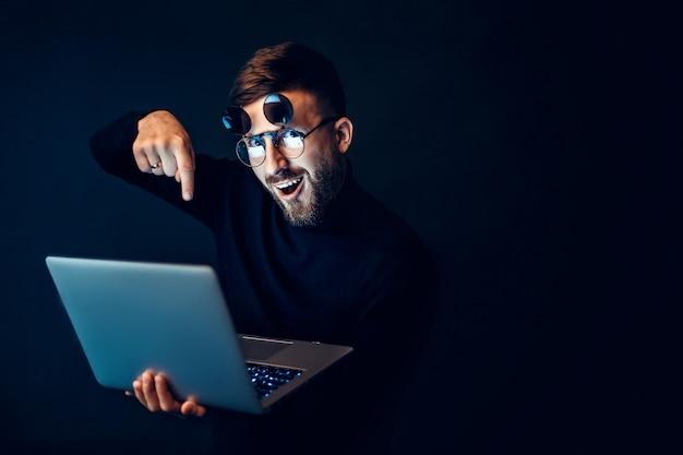 Excited man in glasses holding laptop Premium Photo