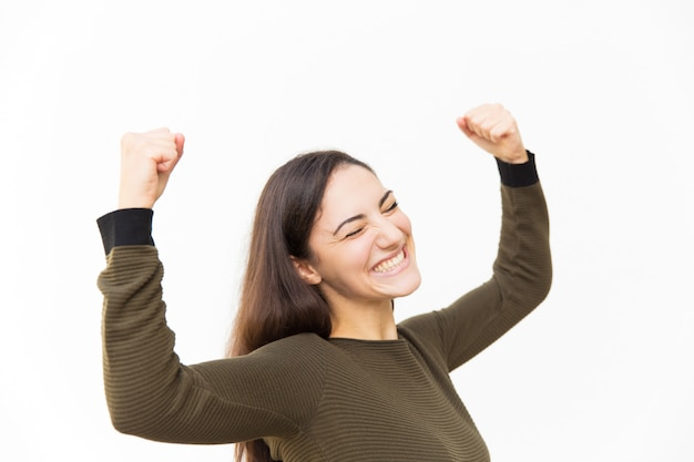 Excited overjoyed beautiful latin woman making winner gesture Free Photo