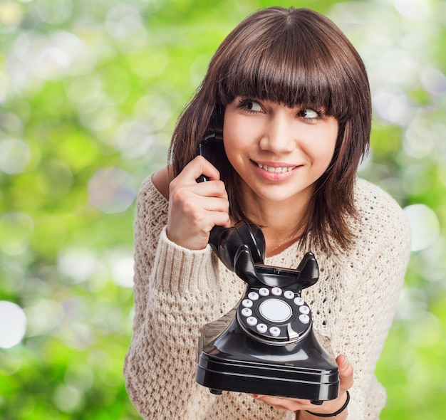 Excited teen using a old telephone Photo | Free Download