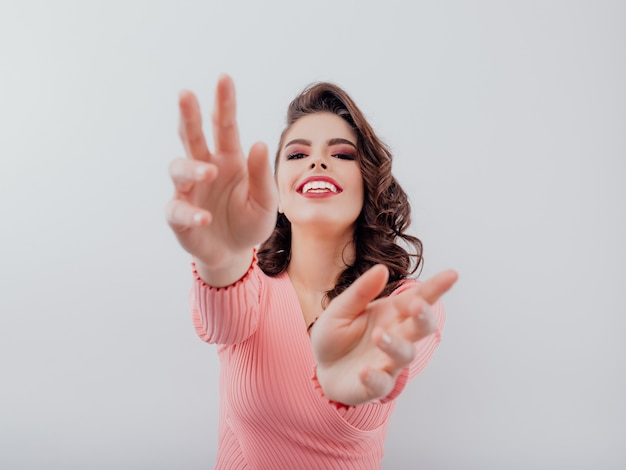 Excited woman stretching out her arms Premium Photo
