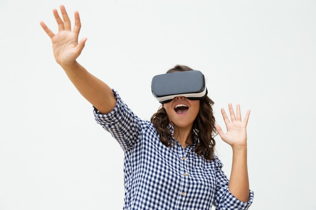 Excited woman using vr headset Free Photo