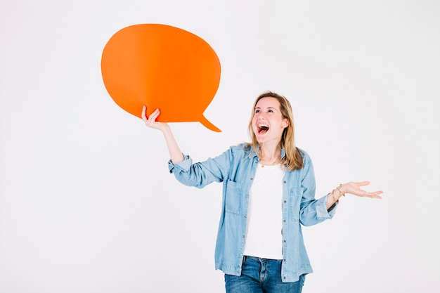Excited woman with speech balloon 23 2147775129