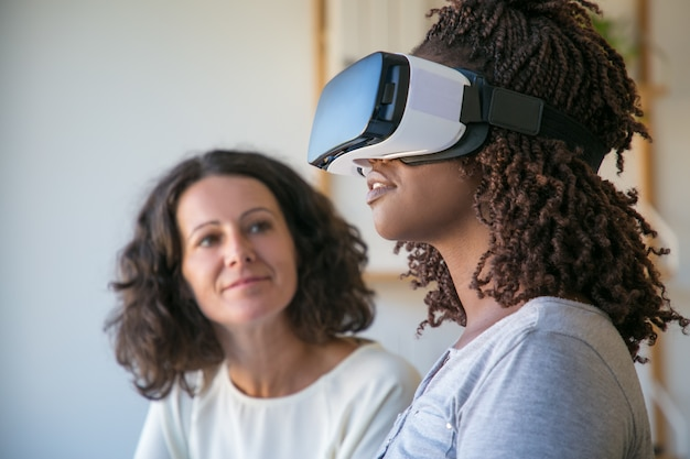 Excited young african american woman in vr headset Free Photo