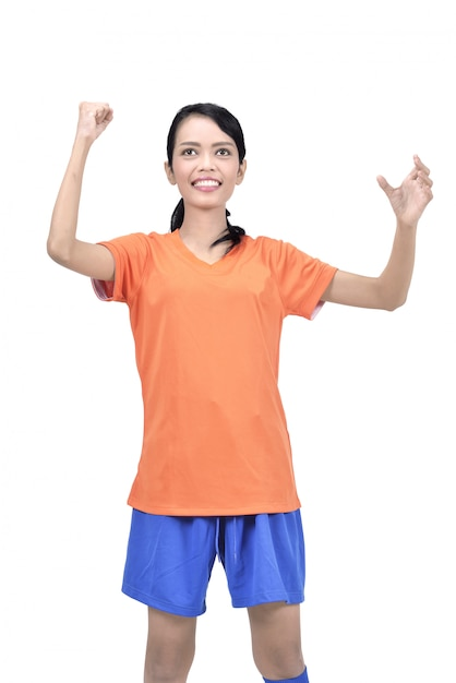 Exited asian footbal player woman with winner expression Premium Photo