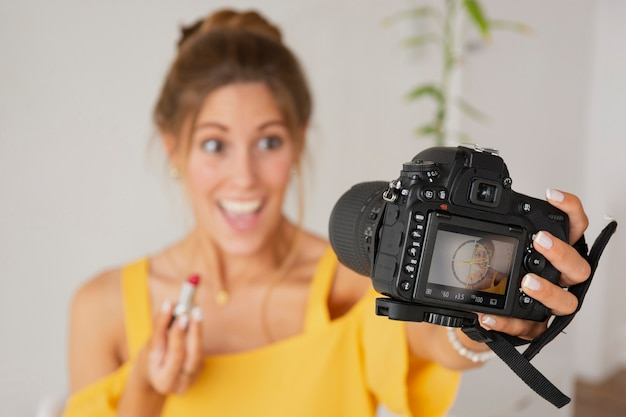Exited female taking photos with beauty products Free Photo