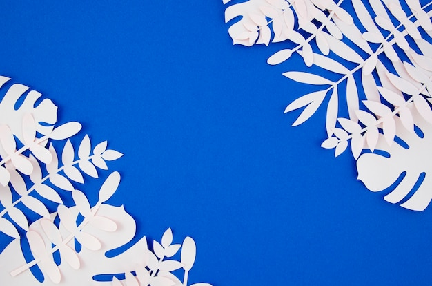 Exotic artificial foliage from paper style with copy space Free Photo