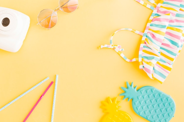 Exotic beach vacation arrangement on yellow background Free Photo