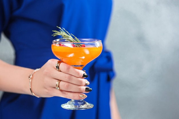 Exotic cocktail and female hands Free Photo